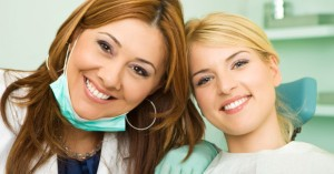 Dentist and patient discussing extractions and wisdom teeth removal