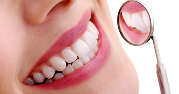 White smiling teeth after cosmetic services